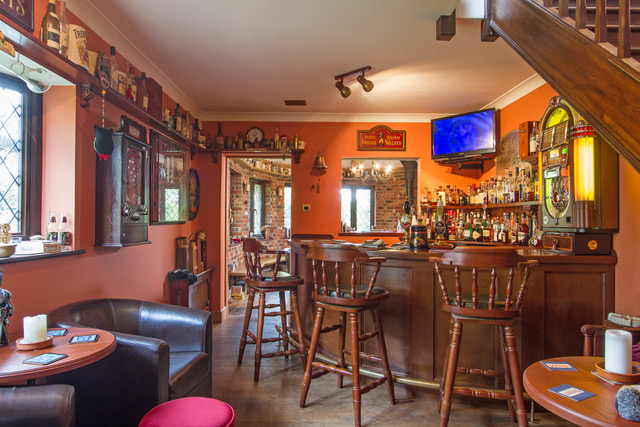 homeowner's private pub with jukebox